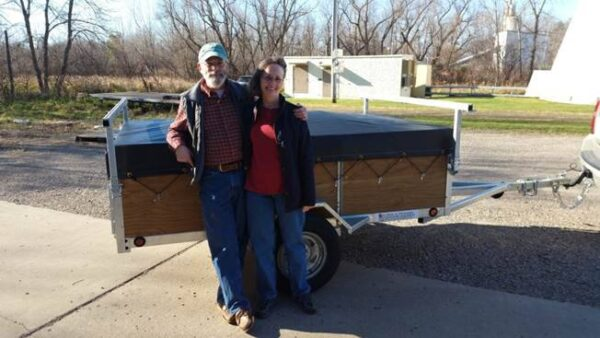Couple with canoe trailer