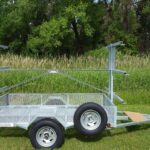 side view of a 5x8 6 place canoe trailer or kayak trailer with mesh gear box
