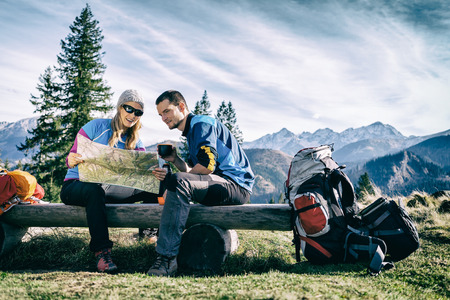 Couple looking at map on their fall camping trip
